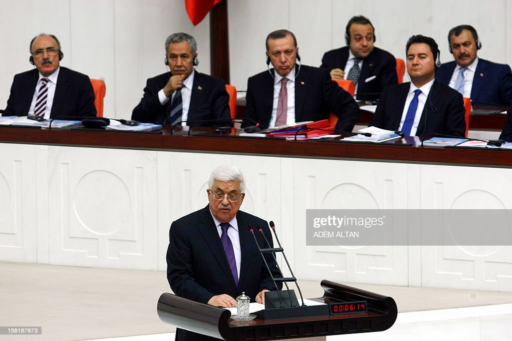 Palestinian president Mahmud Abbas addresses the Turkish Parliament in Ankara on December 10, 2012. The UN General Assembly overwhelmingly backed a resolution to recognise Palestine as a non-member observer state, a move Abbas said on December 5, 2012 was part of 'a last chance' for a negotiated two-state solution. Turkey welcomed the upgrading of the Palestinians' status as a 'significant step', with Foreign Minister Ahmet Davutoglu calling for an independent Palestinian state with east Jerusalem as its capital. In background, at center, Turkish Prime Minister Recep Tayyip Erdogan.
