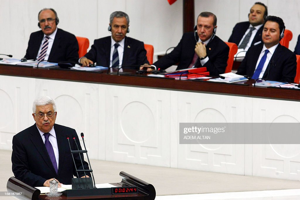 Palestinian president Mahmud Abbas addresses the Turkish Parliament in Ankara on December 10, 2012. The UN General Assembly overwhelmingly backed a resolution to recognise Palestine as a non-member observer state, a move Abbas said on December 5, 2012 was part of 'a last chance' for a negotiated two-state solution. Turkey welcomed the upgrading of the Palestinians' status as a 'significant step', with Foreign Minister Ahmet Davutoglu calling for an independent Palestinian state with east Jerusalem as its capital. In background, second right, Turkish Prime Minister Recep Tayyip Erdogan.