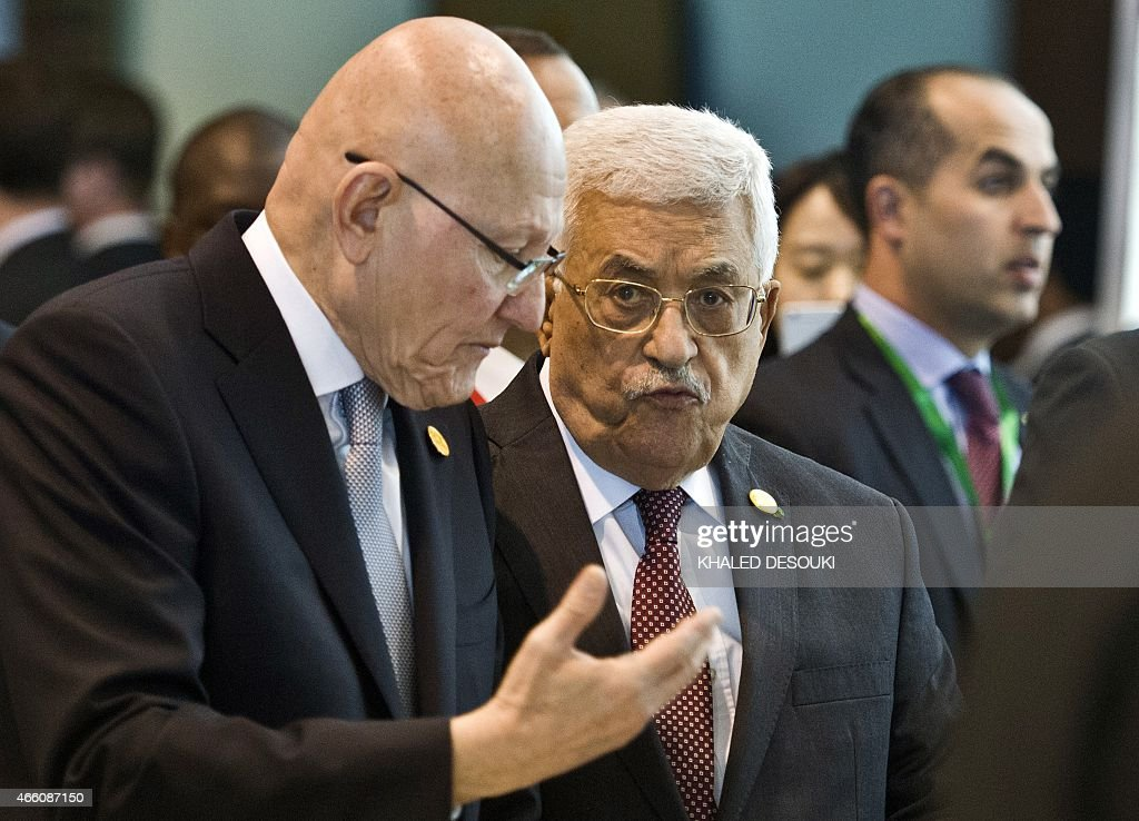 Palestinian president Mahmud Abbas (C) and Lebanese Prime Minister <a gi-track='captionPersonalityLinkClicked' href=/galleries/search?phrase=Tammam+Salam&family=editorial&specificpeople=5769198 ng-click='$event.stopPropagation()'>Tammam Salam</a> (C-L) arrive for the Egypt Economic Development conference on March 13, 2015, in the Red Sea resort of Sharm el-Sheikh.