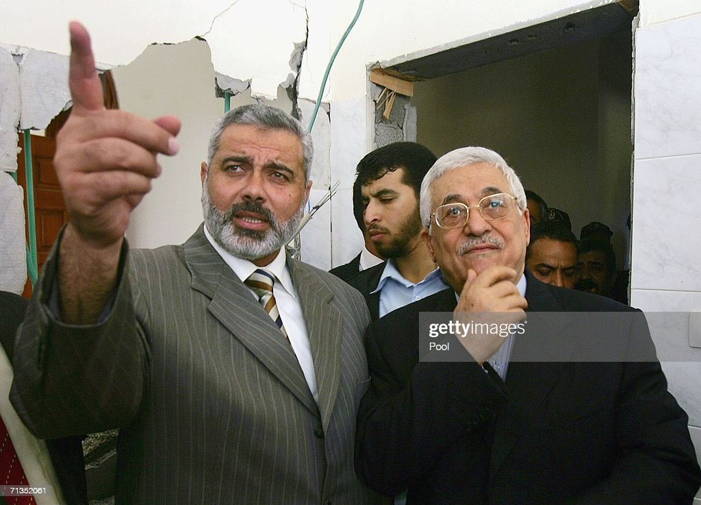 Palestinian President Mahmud Abbas (R) and Prime Minister Ismail Haniya inspect the PM's destroyed Gaza City office which was struck by Israeli planes during an overnight raid, July 2, 2006 in Gaza City, Gaza Strip. Haniya, who was not in his office at the time, condemned the attack, which set his office ablaze following Israeli threats against Hamas leaders, ratcheting up the pressure to rescue an Israeli soldier captured by militants exactly a week ago.