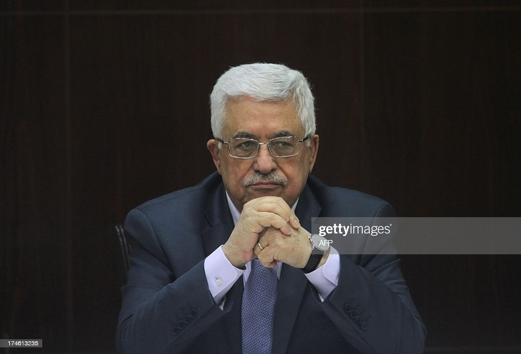 Palestinian president Mahmud Abbas chairs a cabinet session in the West Bank city of Ramallah on July 28, 2013. Israeli Prime Minister Benjamin Netanyahu was seeking cabinet approval for a contentious release of 104 veteran Palestinian and Israeli-Arab prisoners, to coincide with the resumption of peace talks which have been stalled since September 2010.