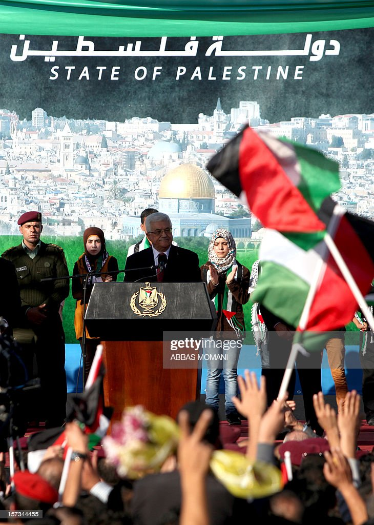 Palestinian president Mahmud Abbas (C) delivers a speech to the crowd upon his arrival in the West Bank city of Ramallah on December 2, 2012, after winning upgraded United Nations status for the Palestinians earlier in the week. Abbas said 'Palestine has accomplished a historic achievement at the UN,' three days after the United Nations General Assembly granted the Palestinians non-member state observer status in a 138-9 vote.