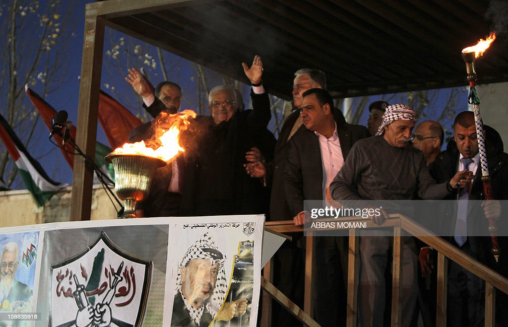 Palestinian President Mahmud Abbas gestures following his speech in front of thousands of Palestinians on the eve of the 48th anniversary of the formation on the Fatah movement, on December 31, 2012, in the West Bank city of Ramallah. The Fatah anniversary commemorates the first operation against Israel claimed by its armed wing then known as Al-Assifa (The Thunderstorm in Arabic) on January 1, 1965. AFP PHOTO/ABBAS MOMANI