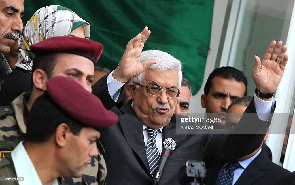 Palestinian President Mahmud Abbas gestures to the crowd as he gives a speech at his headquarters in the West Bank city of Ramallah, on November 25, 2012, where he said he was 'fully confident' ahead of a fresh attempt to seek upgraded Palestinian status at the United Nations on November 29.