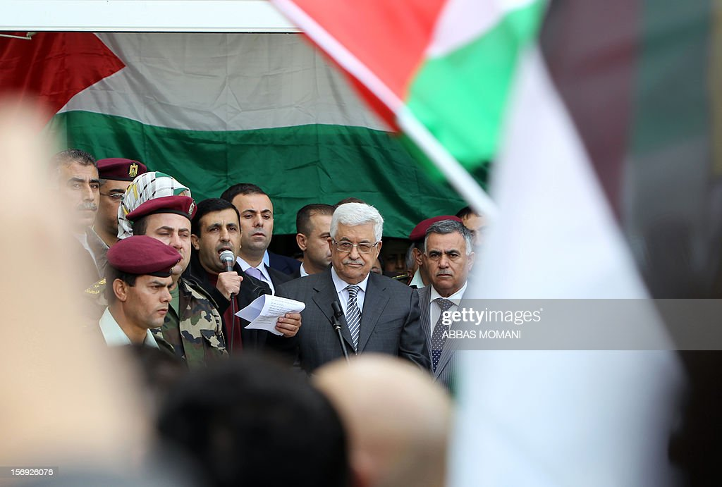 Palestinian President Mahmud Abbas is introduced to the crowd at his headquarters in the West Bank city of Ramallah, on November 25, 2012, where he said he was 'fully confident' ahead of a fresh attempt to seek upgraded Palestinian status at the United Nations on November 29. AFP PHOTO / ABBAS MOMANI