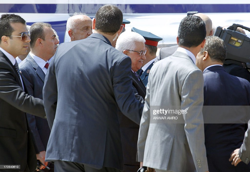 Palestinian president Mahmud Abbas is surrounded by security as he is greeted upon his arrival at Beirut's International Airport, on July 3, 3012. Abbas flew to Lebanon via Jordan, and is expected to offer the Lebanese authorities assurances that the Palestinian refugee camps will stay clear of the country's growing Syria-related unrest.