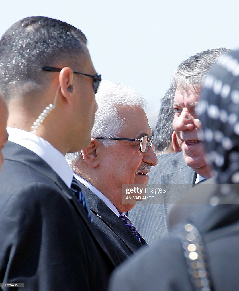 Palestinian president Mahmud Abbas is surrounded by security upon his arrival at Beirut's International Airport, on July 3, 3012. Abbas flew to Lebanon via Jordan, and is expected to offer the Lebanese authorities assurances that the Palestinian refugee camps will stay clear of the country's growing Syria-related unrest during his three day visit.