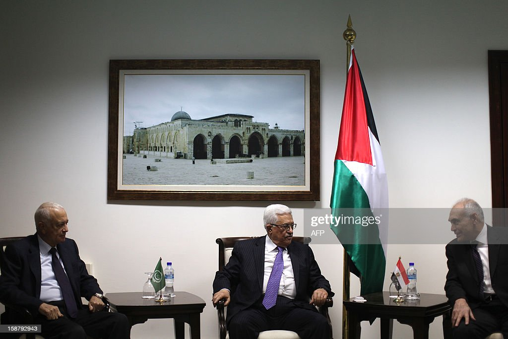 Palestinian president Mahmud Abbas (C) meets with Arab League Secretary General Nabil al-Arabi (L) and Egyptian Foreign Minister Mohamed Kamel Amr (R) upon their arrival in the West Bank city of Ramallah on December 29, 2012. AFP PHOTO / FADI AROURI / POOL