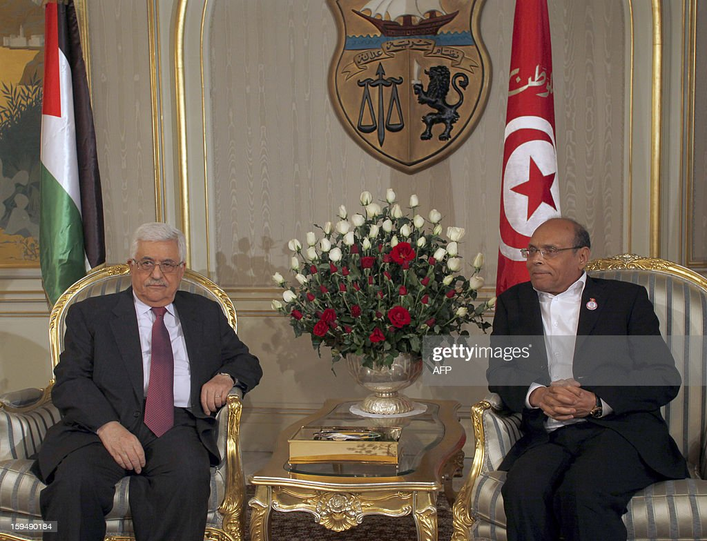 Palestinian President Mahmud Abbas (L) poses neart his Tunisian counterpart Moncef Marzouki prior to a meeting on January 14, 2013 in Tunis. Tunisians mark the second anniversary of the uprising that ousted long-time dictator Zine El Abidine Ben Ali amid a climate of uncertainty marked by social tension, a weak economy, threats from jihadists and a political impasse. AFP PHOTO / KHALIL