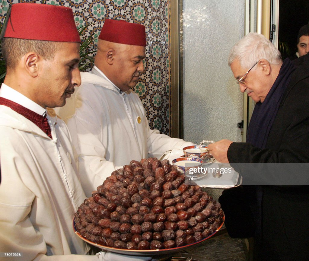 Palestinian President Mahmud Abbas (R) receives dates and milk, according to the Moroccan tradition, prior to his meeting with Moroccan Prime Minister Abbes EL Fassi in Fes, 200kms east of Rabat, 23 November 2007. Abbas was to have talks with Morocco's King Mohammed VI in Fez 23 November during a stopover on his way to Middle East peace talks in the United States, an official Moroccan source said.