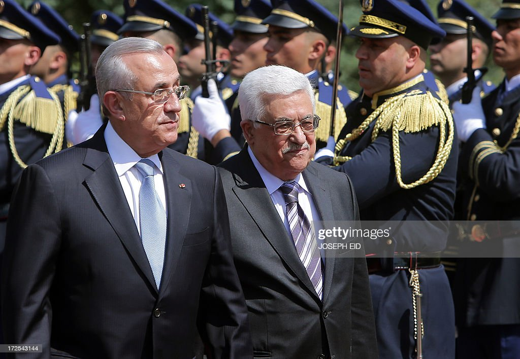 Palestinian president Mahmud Abbas (R) review the guard of honour with Lebanese President Michel Sleiman (L) at the presidential palace of Baabda on July 3, 2013. Abbas flew to Lebanon via Jordan, and is expected to offer the Lebanese authorities assurances that the Palestinian refugee camps will stay clear of the country's growing Syria-related unrest during his three day visit.