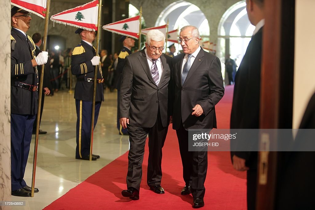 Palestinian president Mahmud Abbas (L) review the guard of honour with Lebanese President Michel Sleiman (R) at the presidential palace of Baabda on July 3, 2013. Abbas flew to Lebanon via Jordan, and is expected to offer the Lebanese authorities assurances that the Palestinian refugee camps will stay clear of the country's growing Syria-related unrest during his three day visit.