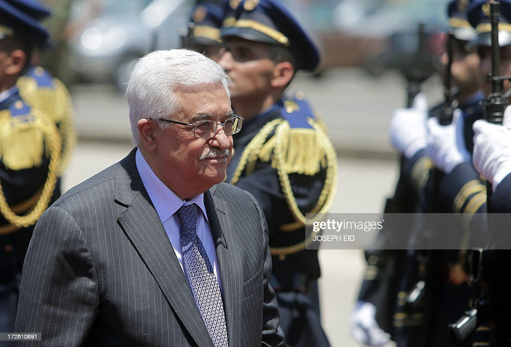 Palestinian president Mahmud Abbas reviews the guard of honour as he arrives in downtown Beirut to place a wreath on the Martyrs Statue on July 4, 2013. Abbas flew to Lebanon via Jordan, and is expected to offer the Lebanese authorities assurances that the Palestinian refugee camps will stay clear of the country's growing Syria-related unrest during his three day visit.