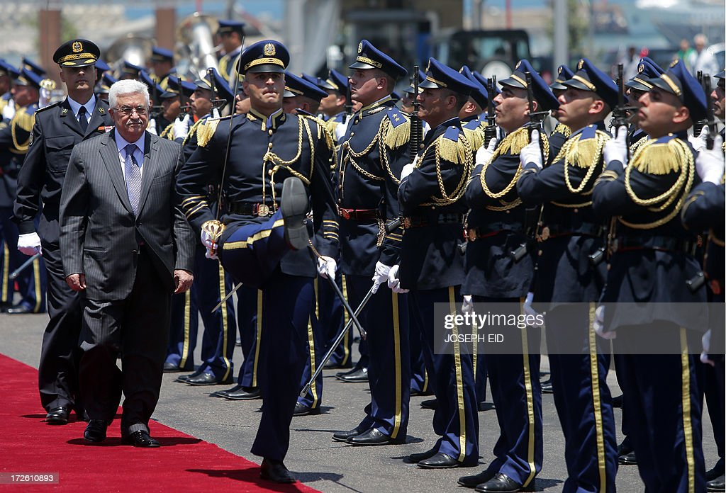 Palestinian president Mahmud Abbas (L) reviews the guard of honour as he arrives in downtown Beirut to place a wreath on the Martyrs Statue on July 4, 2013. Abbas flew to Lebanon via Jordan, and is expected to offer the Lebanese authorities assurances that the Palestinian refugee camps will stay clear of the country's growing Syria-related unrest during his three day visit.