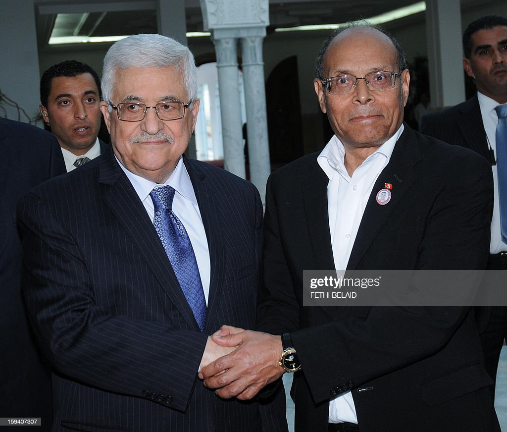 Palestinian President Mahmud Abbas shakes hands with his Tunisian counterpart Moncef Marzouki (R) upon his arrival in Tunis on January 13, 2013.