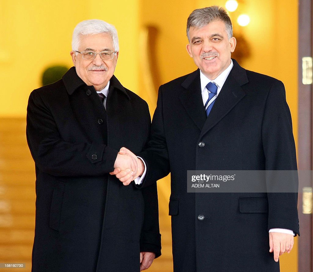 Palestinian president Mahmud Abbas (L) shakes hands with his Turkish counterpart Abdullah Gul during a welcoming ceremony at Cankaya Palace in Ankara on December 11, 2012. Abbas on December 10 vowed to respond if Israel moves ahead with plans to build 3,000 settler homes in east Jerusalem after the Palestinians won non-member observer status at the United Nations.