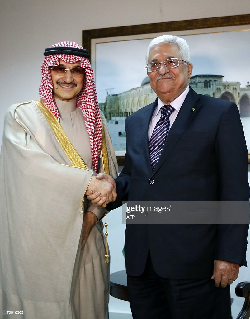 Palestinian President Mahmud Abbas (R) shakes hands with Saudi Arabia's prince Al-Waleed bin Talal during their meeting in the West Bank city of Ramallah on March 4, 2014.