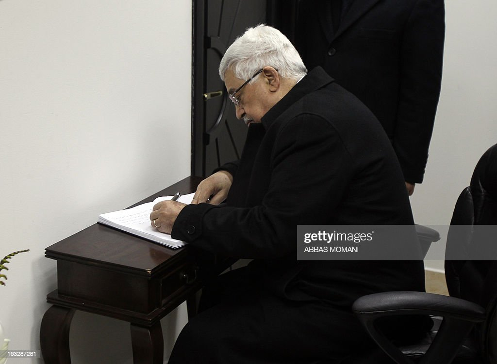 Palestinian president Mahmud Abbas signs the book of condolences for the death of late Venezuelan President Hugo Chavez at the headquarters of the Venezuelan diplomatic mission in Ramallah on March 7, 2013. The 58-year-old leader died on March 4, weakened by a respiratory infection after a fourth round of cancer surgery.