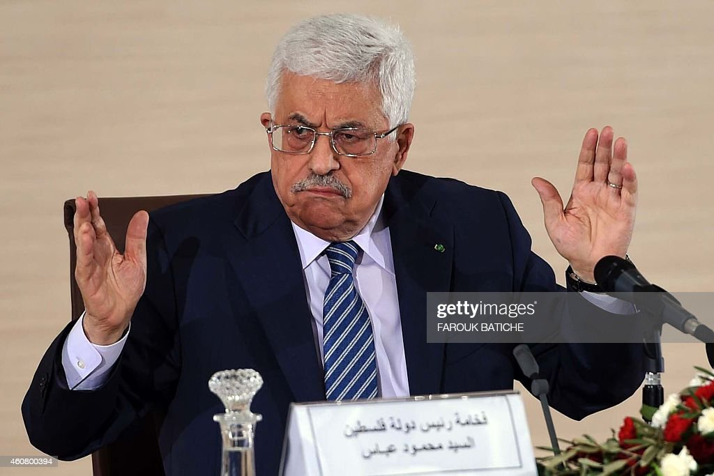 Palestinian President Mahmud Abbas speaks during a press conference held at the Ministry of Foreign Affairs on December 23, 2014, in Algiers. Abbas is on a three-day official visit and met the day before Algerian President Abdelaziz Bouteflika. AFP PHOTO / FAROUK BATICHE