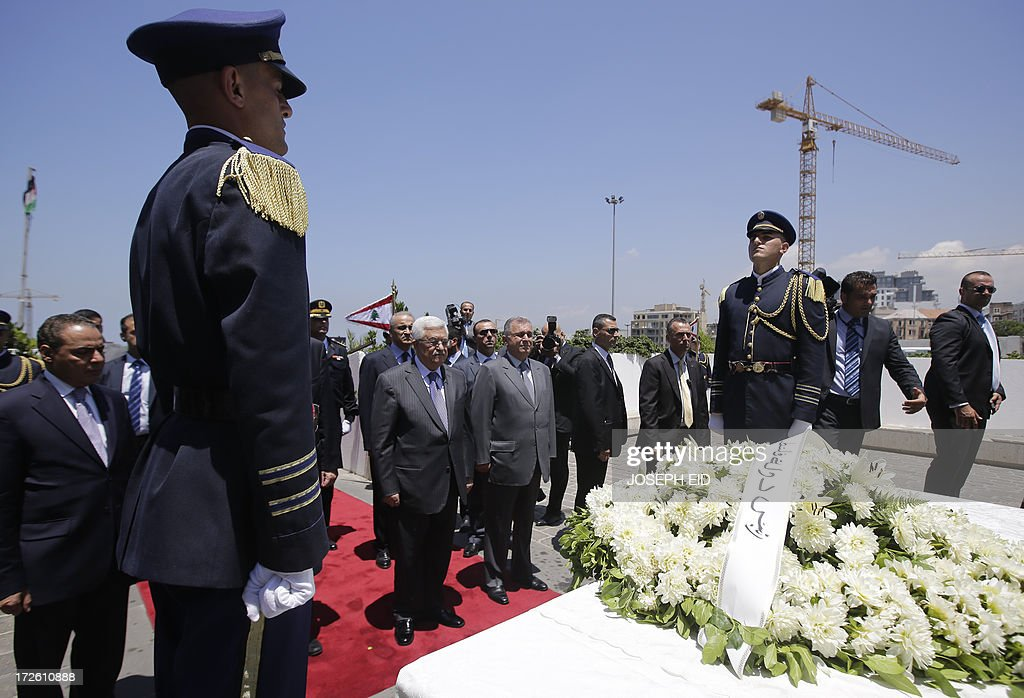 Palestinian president Mahmud Abbas (C-L) stands after laying a wreath on the Martyrs Statue in downtown Beirut on July 4, 2013. Abbas flew to Lebanon via Jordan, and is expected to offer the Lebanese authorities assurances that the Palestinian refugee camps will stay clear of the country's growing Syria-related unrest during his three day visit. AFP PHOTO/JOSEPH EID