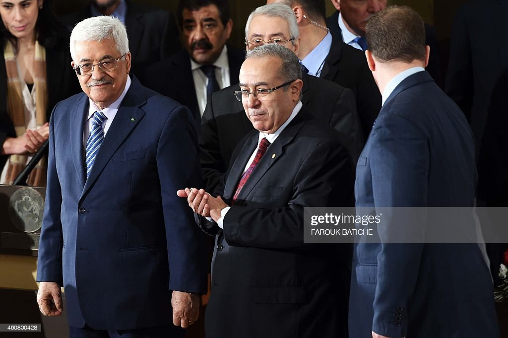 Palestinian President Mahmud Abbas (L) stands next to Algerian Foreign Minister <a gi-track='captionPersonalityLinkClicked' href=/galleries/search?phrase=Ramtane+Lamamra&family=editorial&specificpeople=5486120 ng-click='$event.stopPropagation()'>Ramtane Lamamra</a> (C) before a press conference held at the Ministry of Foreign Affairs on December 23, 2014, in Algiers. Abbas is on a three-day official visit and met the day before Algerian President Abdelaziz Bouteflika. AFP PHOTO / FAROUK BATICHE