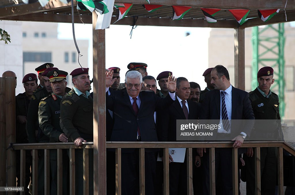 Palestinian president Mahmud Abbas (C) waves to the crowd upon his arrival in the West Bank city of Ramallah on December 2, 2012, after winning upgraded UN status for the Palestinians. Abbas said 'Palestine has accomplished a historic achievement at the UN,' three days after the United Nations General Assembly granted the Palestinians non-member state observer status in a 138-9 vote.