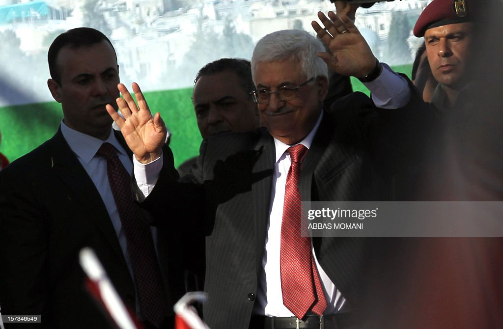 Palestinian president Mahmud Abbas (C) waves to the crowd upon his arrival in the West Bank city of Ramallah on December 2, 2012, after winning upgraded United Nations status for the Palestinians earlier in the week. Abbas said 'Palestine has accomplished a historic achievement at the UN,' three days after the United Nations General Assembly granted the Palestinians non-member state observer status in a 138-9 vote.
