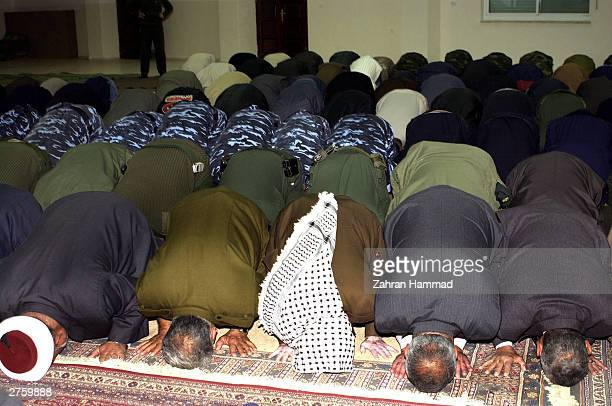 Palestinian President Yasser Arafat offers prayers November 25 2003 for Eid alFitr in Ramallah the West Bank Muslims over the world will visit graves...