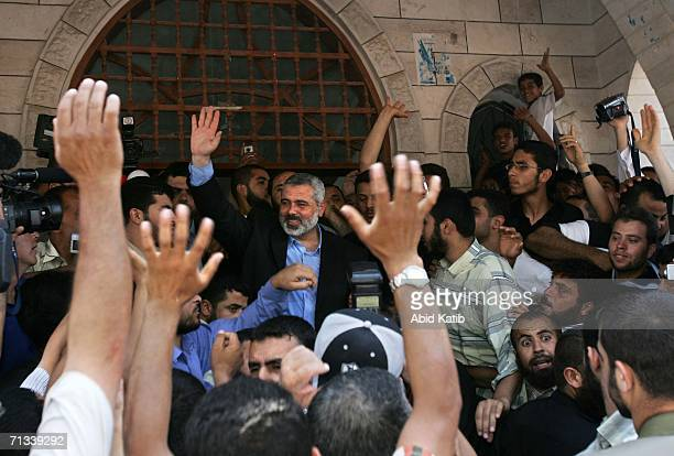 Palestinian Prime Minister and Hamas leader Ismail Haniyeh waves to worshippers after he finished the weekly Friday prayer in Al Mohatah mosque on...