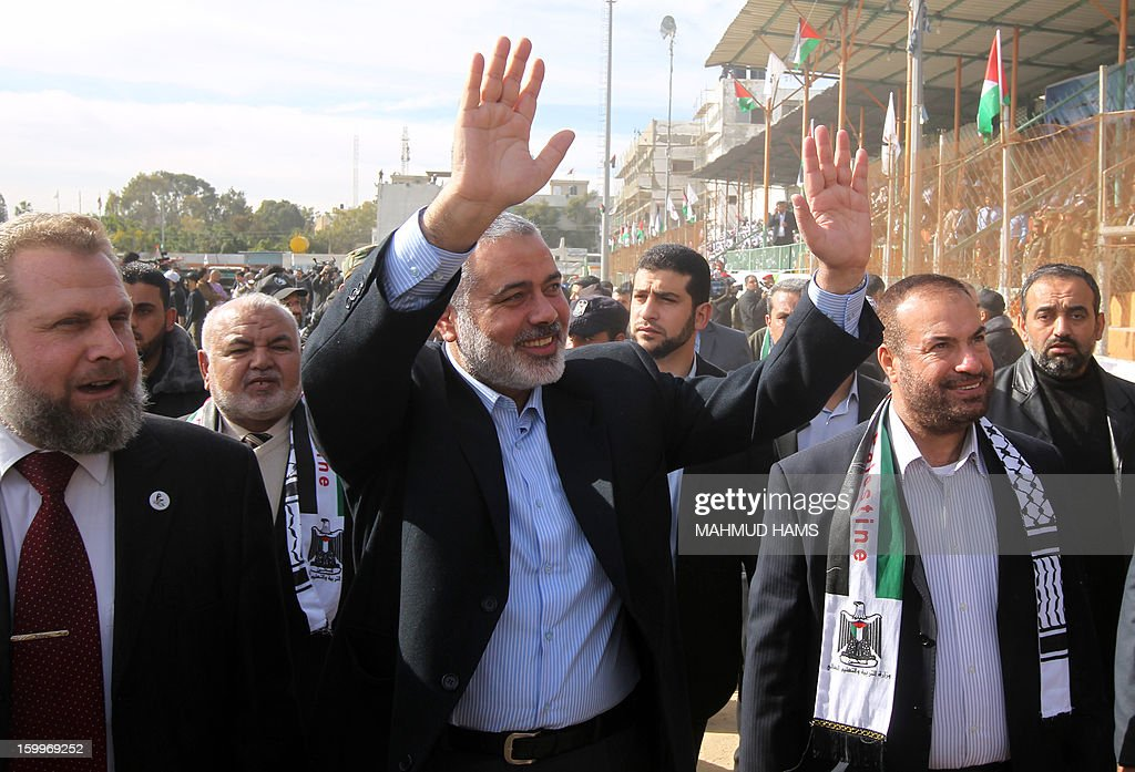 Palestinian Prime Minister in the Hamas-run Gaza Strip Ismail Hanyia waves during a graduation ceremony for high-school students from a military school course organised by the Hamas security forces and the Hamas Minister of Education on January 24, 2013 in Gaza City. AFP PHOTO/MAHMUD HAMS