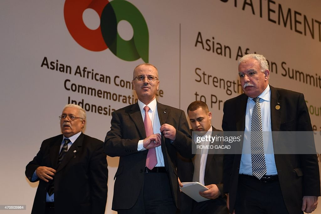 Palestinian Prime Minister Rami Hamdallah (C), Foreign Affairs Minister Riyad al-Malki (L) and Ambassador to Indonesia Fariz Mehdawi (R) leave after Hamdallah delivered a statement at a press conference following a bilateral meeting with Indonesian President Joko Widodo on the sidelines of the Asian African Conference in Jakarta on April 21, 2015.
