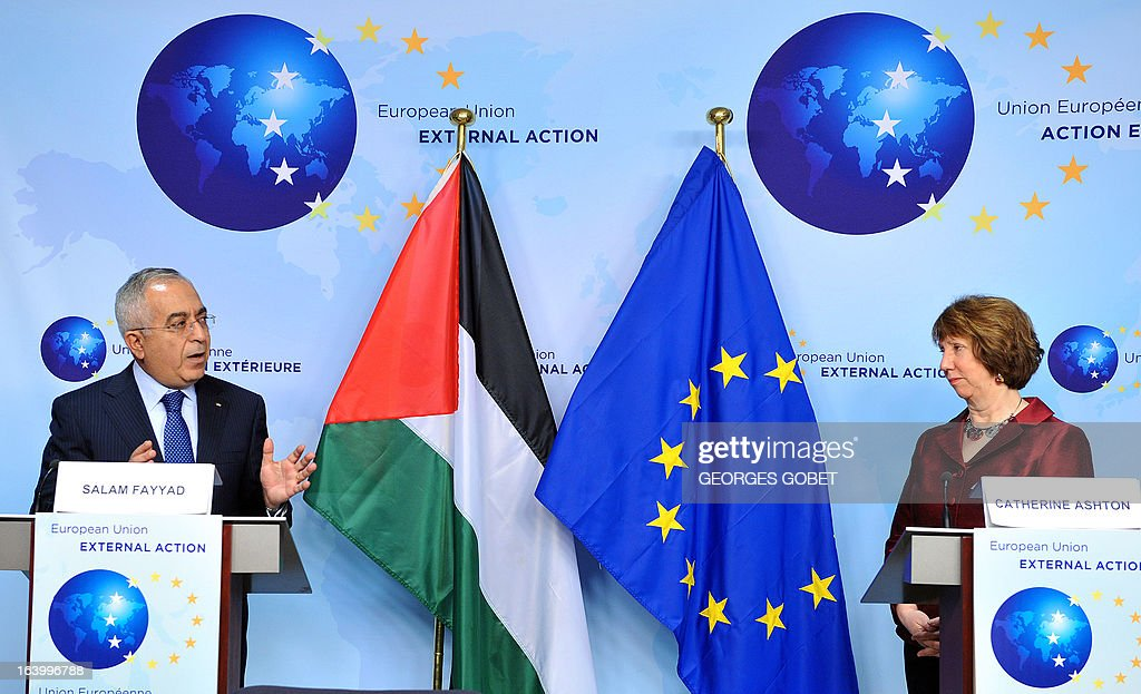 Palestinian Prime Minister Salam Fayyad (L) and EU foreign policy chief Catherine Ashton make a statement to the press on March 19, 2013 before a signing ceremony at EU headquarters in Brussels ahead of the opening of the annual coordination meeting of Palestinian aid donors.