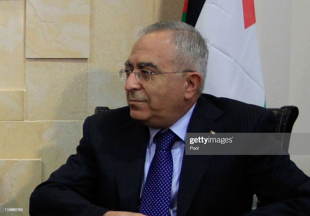Palestinian Prime Minister <a gi-track='captionPersonalityLinkClicked' href=/galleries/search?phrase=Salam+Fayyad&family=editorial&specificpeople=2162597 ng-click='$event.stopPropagation()'>Salam Fayyad</a> listens during his meeting with US Defense Secretary Robert Gates on March 25, 2011 in Ramallah, West Bank. As part of his official visit to the Middle East, US Defense Secretary Robert Gates arrived in the West Bank two days after a bomb explosion at a bus stop in central Jerusalem killed one woman and injured over 20 people, followed by Israeli strikes against Hamas in the Gaza Strip. The first trip to the West Bank city of Ramallah by a US defense chief, Gates is expected to discuss a two-state solution for peace between the Palestinians and Israelis.