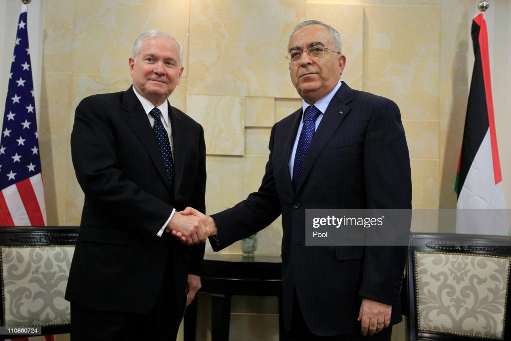 Palestinian Prime Minister <a gi-track='captionPersonalityLinkClicked' href=/galleries/search?phrase=Salam+Fayyad&family=editorial&specificpeople=2162597 ng-click='$event.stopPropagation()'>Salam Fayyad</a> shakes hands with visiting US Defense Secretary Robert Gates (L) on March 25, 2011 in Ramallah, West Bank. As part of his official visit to the Middle East, US Defense Secretary Robert Gates arrived in the West Bank two days after a bomb explosion at a bus stop in central Jerusalem killed one woman and injured over 20 people, followed by Israeli strikes against Hamas in the Gaza Strip. The first trip to the West Bank city of Ramallah by a US defense chief, Gates is expected to discuss a two-state solution for peace between the Palestinians and Israelis.