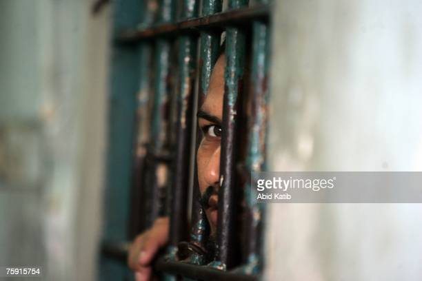Palestinian prisoner looks out of a cell in the Hamascontrolled Saraya jail August 1 2007 in Gaza City Gaza Strip According to the Saraya jail...