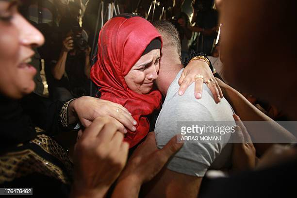 Palestinian prisoners freed from Israeli detention are greeted in the city of Ramallah on August 14 2013 The release of the prisoners all but one of...