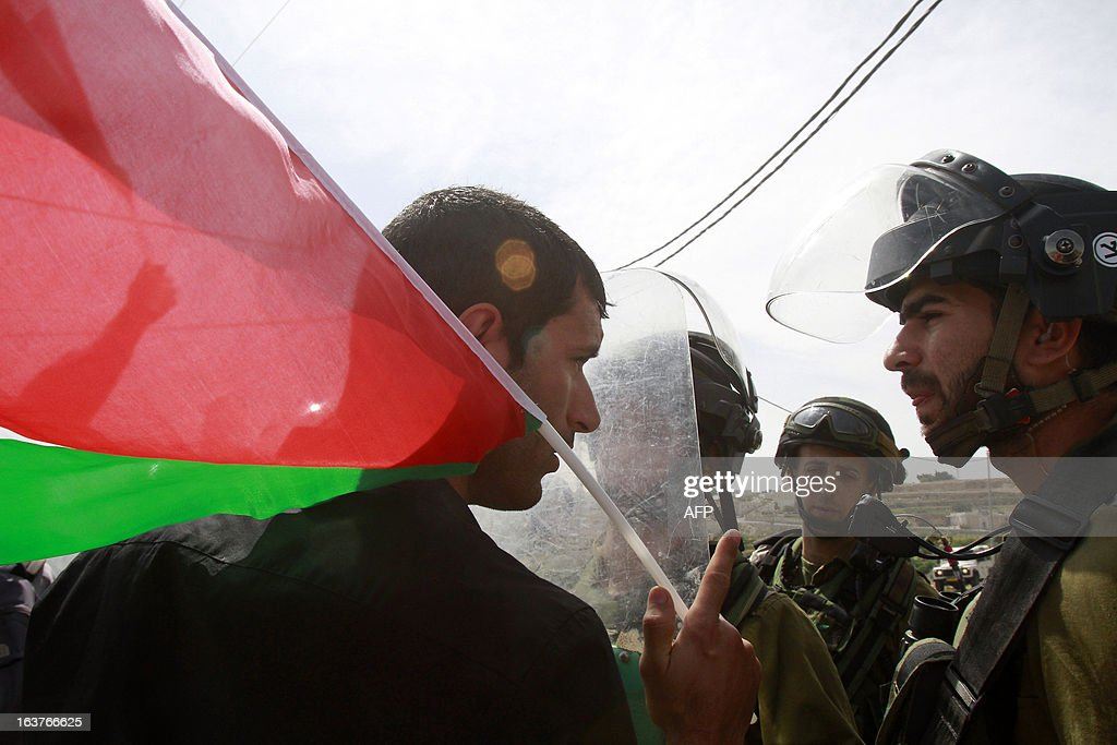 A Palestinian protester argues with Israeli soldiers during a weekly demonstration against the Israeli occupation and the expansion of Jewish settlements in the West Bank village of Maasarah near Bethlehem on March 15, 2013.