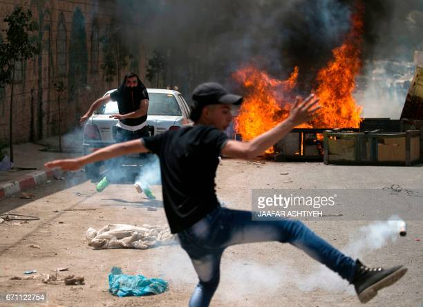 Palestinian protester dodges teargas cannisters during clashes with Israeli forces in the West Bank village of Beita southeast of Nablus city after a...