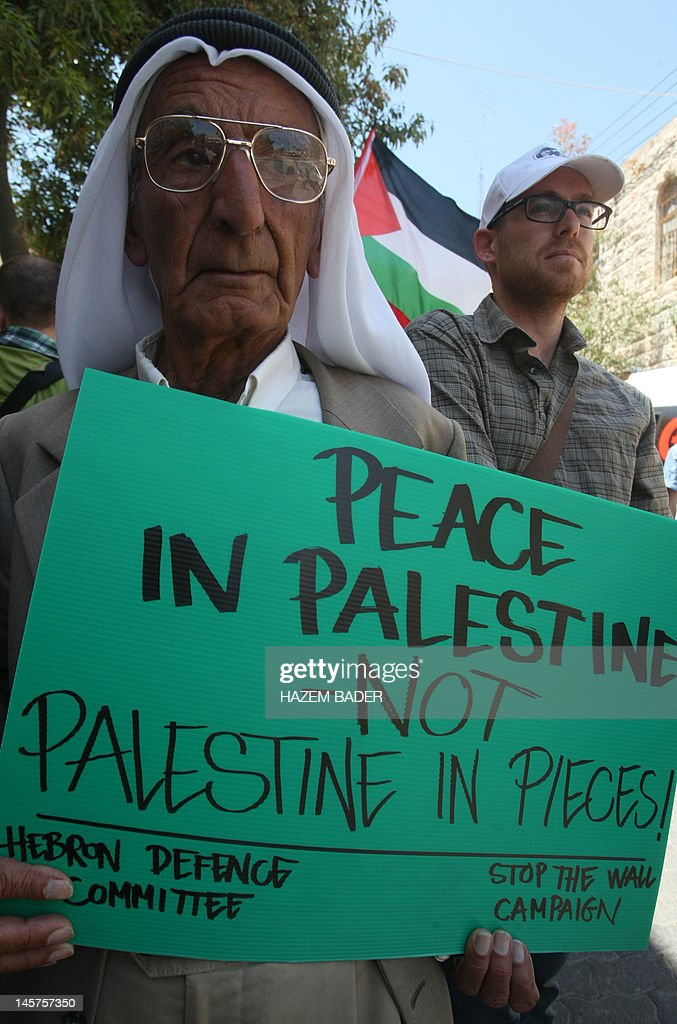 A Palestinian protester holds a sign during a demonstration against the Israeli occupation and to mark 'Naksa Day' the 45th anniversary of the 1967...