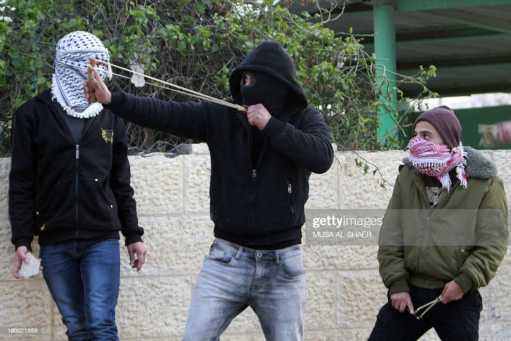 A Palestinian protester hurls stones at Israeli security forces during clashes in the Aida Palestinian refugee camp near the West Bank city of Bethlehem on January 24, 2013. The Palestinian leadership wants new dialogue with Israeli political parties, particularly centrists who emerged strong in this week's election, an official said.