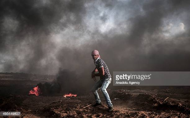 Palestinian protester is seen during a demonstration against Israeli Government's violations at AlAqsa Mosque on October 20 2015 near alBureij...