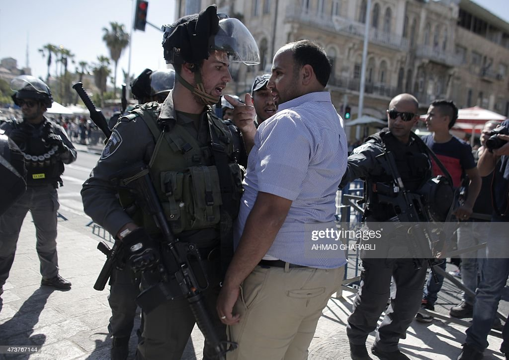 A Palestinian protester scuffles with Israeli security forces outside Damascus Gate in Jerusalem's old city on May 17 as Israeli nationalists take...