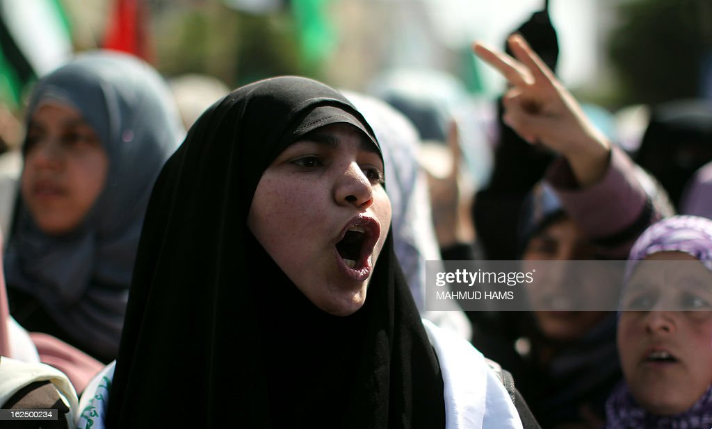 A Palestinian protester shouts slogans during a demonstration in Gaza City in solidarity with Palestinian prisoners on February 24, 2013. Some 3,000 Palestinians held in Israeli jails were staging a one-day hunger strike in protest at the death of an inmate, an official said, as security forces clashed with demonstrators in the West Bank.