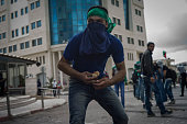 Palestinian protester throws rocks during clashes with IDF and Israeli Border Police on October 8 2015 in BeitEl WestBank As Tension rises between...