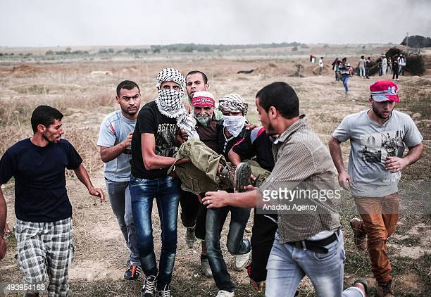 Palestinian protester wounded by Israeli forces' attack during a demonstration against Israeli Government's policies and violations over AlAqsa...