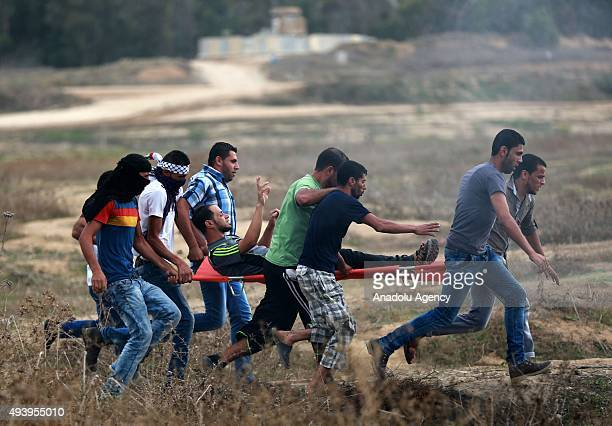 Palestinian protester wounded by Israeli forces' attack is being carried by other protesters during a demonstration against Israeli Government's...