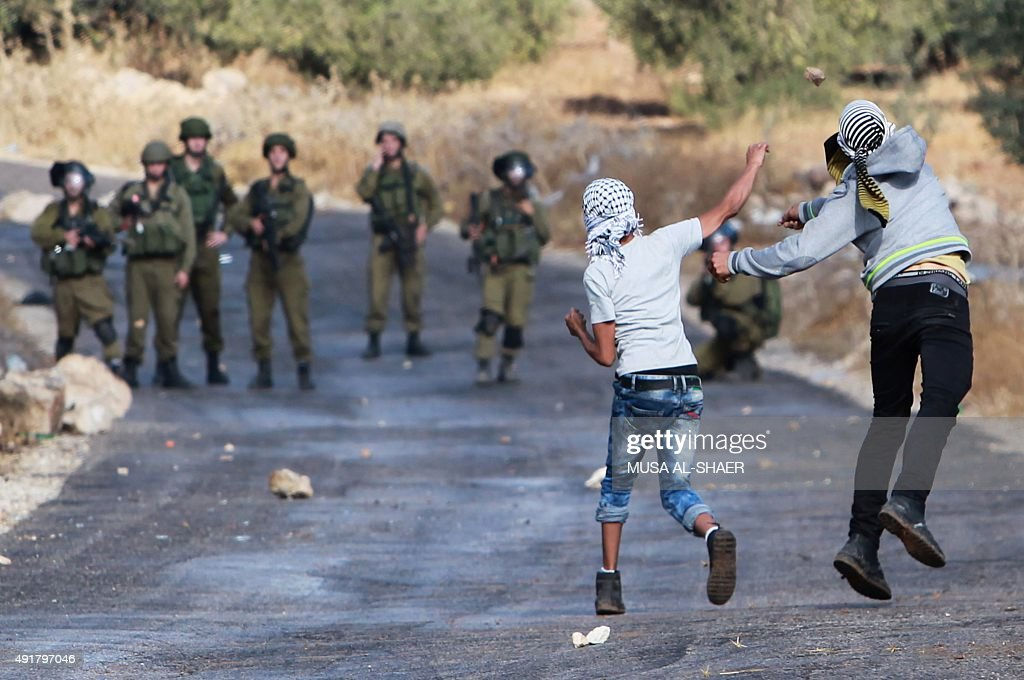 Palestinian protesters and Israeli security forces clash in the West Bank village of Tuqua southeast of Bethlehem on October 8 2015 New violence...