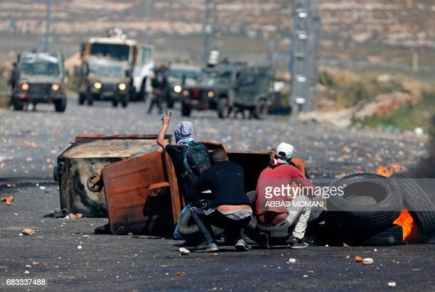 Palestinian protesters clash with Israeli security forces following a protest marking the 69th anniversary of the Nakba which remembers those...