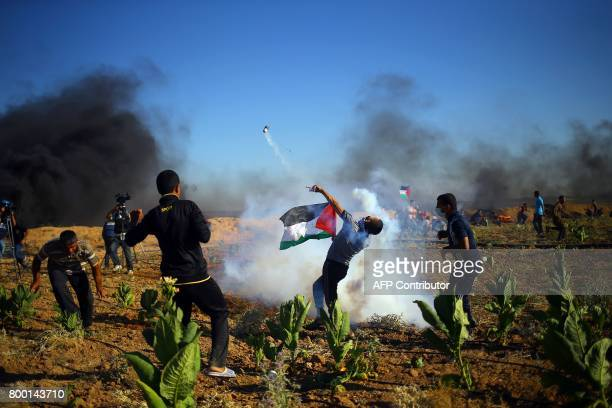 Palestinian protesters clash with Israeli security forces near the border fence east of Jabalia refugee camp on June 23 following a demonstration...