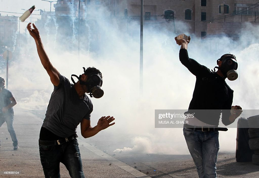 Palestinian protesters clash with Israeli security forces on October 14 2015 in the West Bank city of Bethlehem Israel began setting up checkpoints...